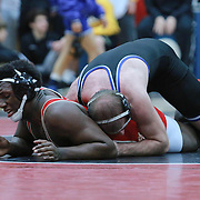 Charter School of Wilmington Andrew Genett and William Penn Myles Goodson grapple in a 195 pound bout during the Blue Hen Conference Wrestling Tournament Finals Saturday, Feb. 20, 2016 at William Penn High School in New Castle.