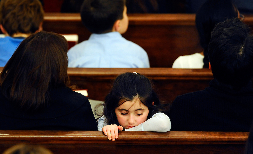 A child sits with her family in a pew during an interfaith a sermon at Newtown Congregational Church in Newtown, Conn., Sunday, Jan. 20, 2013. The Rev. James A. Forbes, Jr., who led one of the countryís most prominent liberal Protestant churches, is speaking at the church to honor the victims of last monthís school shooting and the legacy of the Rev. Martin Luther King Jr. (AP Photo/Jessica Hill)