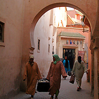 North Africa, Africa, Morocco, Marrakesh. Women return from market in the souks of Marrakesh.