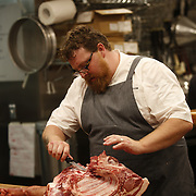 SHOT 8/14/13 7:03:41 PM - Justin Brunson, Owner and Executive Chef at Old Major restaurant in Denver, Co. Includes images of menu items : The Nose to Tail Plate : confit rib, pork chop, crispy belly, city ham, crispy ear, Denver Bacon Co. barbecue beans, cole slaw and corn bread $29 and Pan Seared Scallops : baby vegetables, fregola, spinach purée, toasted pine nuts, roasted garlic vinaigrette $27. The restaurant focuses on heritage-raised meats from Colorado farms, features an in-house butchery program and bills itself as contemporary farmhouse cuisine. (Photo by Marc Piscotty / © 2013)