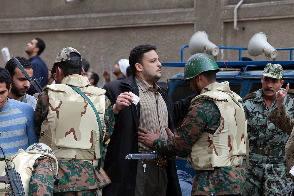 "Protesters are searched by the Egyptian military as they enter a ""million man march"" demonstration February 01, 2011 in Central Cairo's Tahrir, or ""Liberation"" square. The march capped a week of protests that are threatening to bring down the nearly 30 year old regime of Hosni Mubarak."
