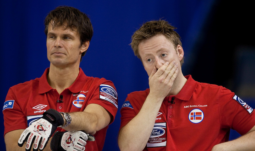 Norwegian skip Thomas Ulsrud, left and third Torger Nergaard react to a missed shot in their 7-6 loss to Sweden in the bronze medal match at the Ford World Men's Curling Championships in Regina, Saskatchewan, April 10, 2011.<br /> AFP PHOTO/Geoff Robins