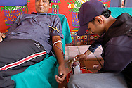 People donating blood at a street blood bank., Patan's Durbar Square. Patan. B1276