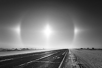 We were heading out of the city to the south on Hwy 2 when we saw this Sun Dog form in the ice fog and blowing snow. We were able to see it for well over an hour as we drove through the prairie landscape and it was an amazing sight to see!<br /> <br /> &copy;2014, Sean Phillips<br /> http://www.RiverwoodPhotography.com