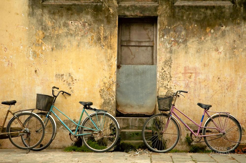 Parked bikes at at street of Hoi An