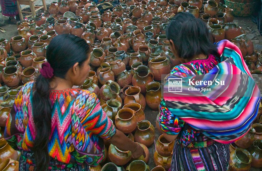Selling pottery at the market, Chichicastenango, Guatemala