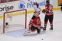 May 25, 2012; Newark, NJ, USA; New York Rangers left wing Brandon Dubinsky (17) celebrates a goal by New York Rangers right wing Ryan Callahan (24) on New Jersey Devils goalie Martin Brodeur (30) during the second period in game six of the 2012 Eastern Conference finals at the Prudential Center.