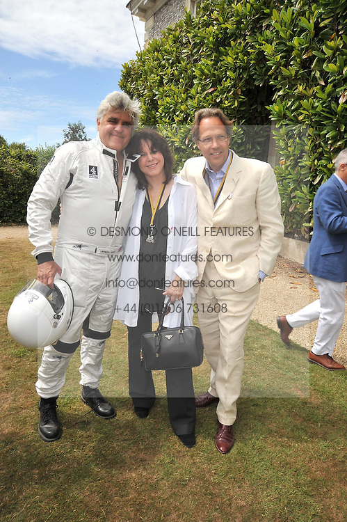 Left to right, JAY LENO, his wife MAVIS and the EARL OF MARCH at a luncheon hosted by Cartier for their sponsorship of the Style et Luxe part of the Goodwood Festival of Speed at Goodwood House, West Sussex on 5th July 2009.