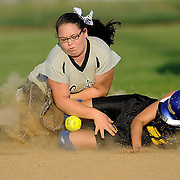 Warren East's Chelsea Martin slides in under the throw to Warren Central's Kaitlyn Bowling Warren East defeated Warren Central 7-1 in softball Tuesday, April 3, 2012,   at Warren Central.(Photo by Joe Imel/Daily News)