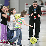 03/20/2014- Stevens Point, Wisc. - Hannah Artner, A15, leads a group of children from Jefferson Elementary School in Stevens Point, Wisc., during a community service outing for the NCAA Division III Women's Final Four on Mar. 20, 2014. (Kelvin Ma/Tufts University)