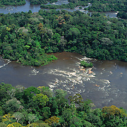 Aerial view of Jari River, northern tributary of the Amazon, coming down from Guyana Highlands showing  rapids and lush rainforest.