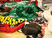A woman sleeps amidst a sea of blankets inside the Capitol building Thursday night, February 17, 2011, in Madison, Wis. Many protesters stayed overnight in the Capitol to continue their demonstration against Gov. Walker's proposed Budget Repair Bill.