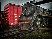 Retired steam locomotive and active boxcar at Steamtown, USA, National Park.