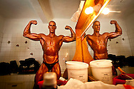 For two years in a row, in a rundown theater in Porto, the Portuguese National Championship of Bodybuilding WABBA happened. Several athletes, from allover the country came to this one day competition. <br /> These are photos from the backstage, where the athletes exercise and get body paint for the stage presentation. The muscles and the gold and brown colors get ready in the confusion of tubes, abandoned wood from different theater plays, photos from the past and dressing rooms with 100 years old.
