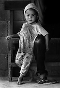 A boy with his father in a village near Luang Prabang, Laos.