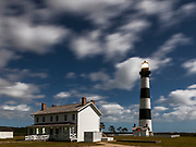 NC00709-00...NORTH CAROLINA...A full moon lights up Bodie Island Lighthouse in Cape Hatteras National Seashore on the Outer Banks.