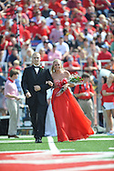 Senior maid McKenzie Lowery (right) is escorted by Ole Miss pole vaulter Sam Kendricks at Ole Miss vs. Auburn at Vaught-Hemingway Stadium in Oxford, Miss. on Saturday, October 13, 2012.