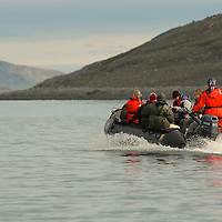 Tourists return from a zodiak ride in Southern Baffin Island, Southern Baffin Island. Canadian Arctic. Arctic Ocean.