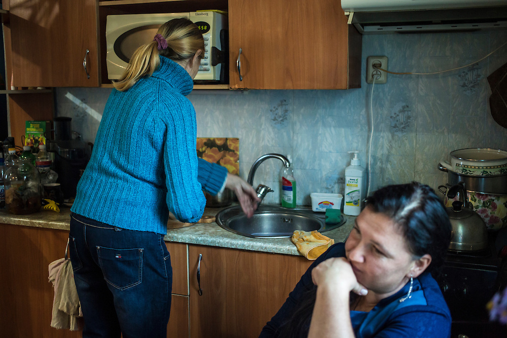 DNIPROPETROVSK, UKRAINE - OCTOBER 12: Svitlana Kostromina (L) in the kitchen at the home of Vira Luchnikova (R), part of her church's congregation where she, her daughter, and her granddaughter are living after fleeing fighting in Luhansk in Ukraine's East on October 12, 2014 in Dnipropetrovsk, Ukraine. The United Nations has registered more than 360,000 people who have been forced to leave their homes due to fighting in the East, though the true number is believed to be much higher. (Photo by Brendan Hoffman/Getty Images) *** Local Caption *** Svitlana Kostromina;Vira Luchnikova