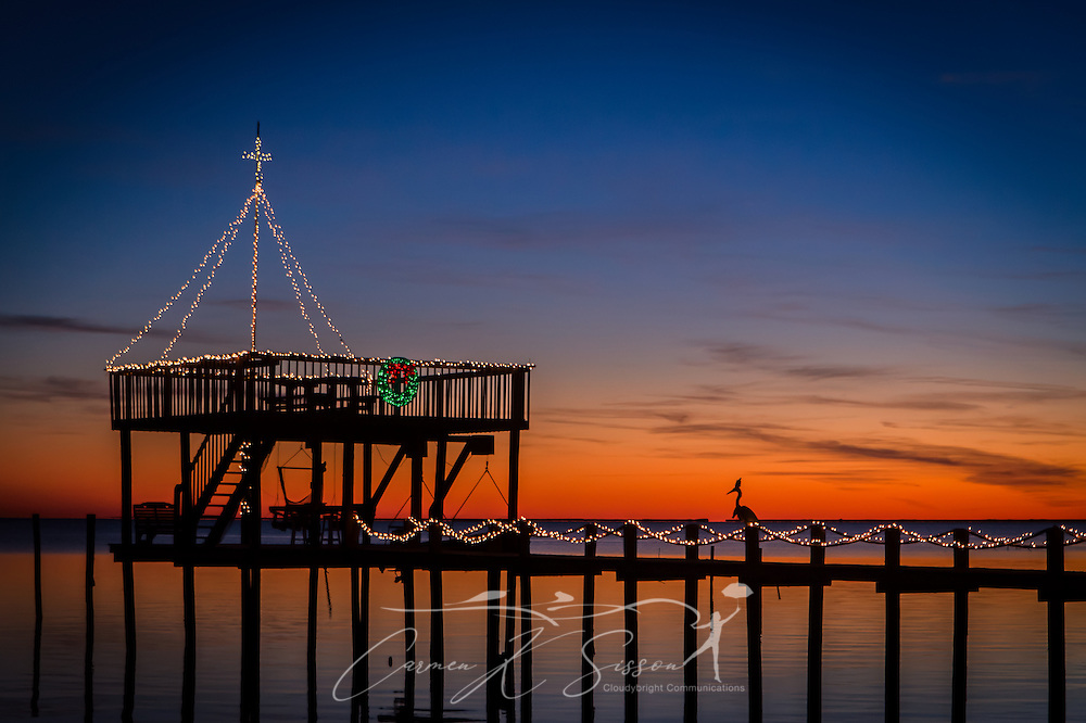 Christmas lights adorn a dock on Coden Beach in Coden, Alabama, Dec. 24, 2013. (Photo by Carmen K. Sisson/Cloudybright)