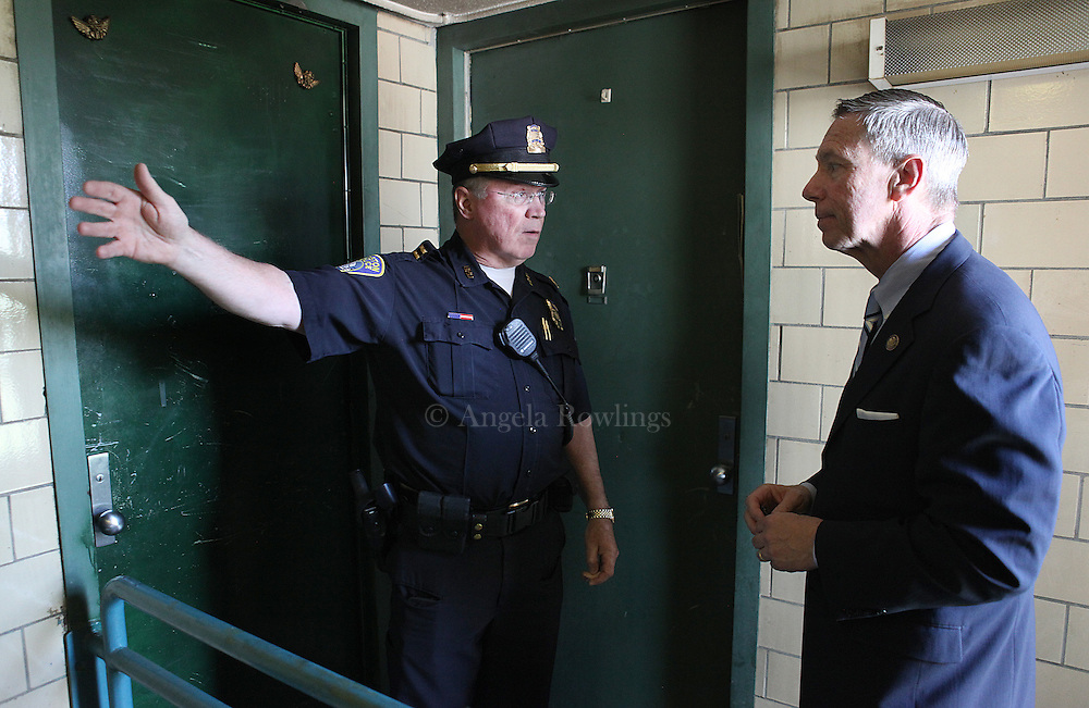 (052912  Boston, MA) Boston Police Capt. John Greland talks with Rep. Stephen Lynch outside the third-floor apartment at 4 Linskey-Barry Court, where a man and woman were found dead in South Boston, Tuesday,  May 29, 2012.  Staff photo by Angela Rowlings.