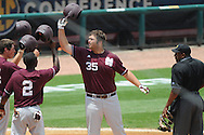 Mississippi State's Wes Rea  hits a three run home run in the first inning vs. Arkansas in the SEC Tournament at Regions Park in Hoover, Ala. on Tuesday, May 22, 2012.