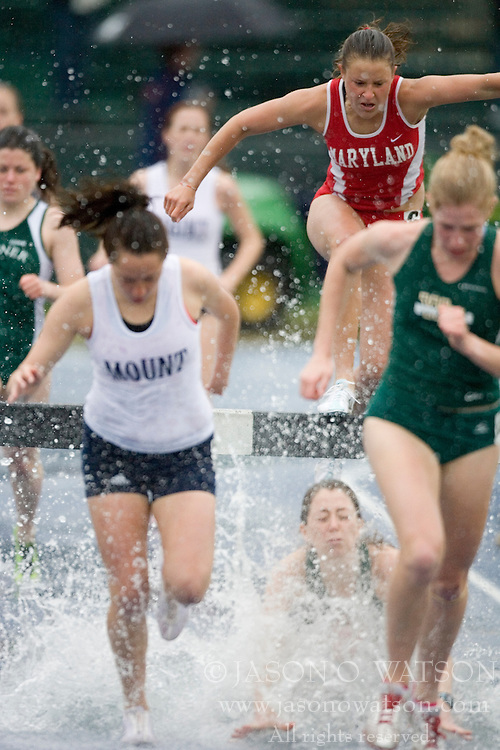 A William and Mary runner falls into the water hazard during the women's 3000m steeple chase.  The University of Virginia Track and Field team hosted the 2007 Lou Onesty Invitational Track Meet at the University of Virginia in Charlottesville, VA on April 14, 2007.