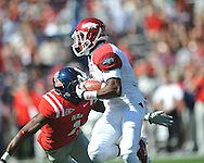 Ole Miss' Damien Jackson (1) vs. Arkansas wide receiver Joe Adams (3) at Vaught-Hemingway Stadium in Oxford, Miss. on Saturday, October 22, 2011. .