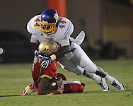 Lafayette High's Demarkous Dennis (5) is tackled by Oxford High's Xavier Pegues (44) at William L. Buford Stadium in Oxford, Miss. on Friday, September 2, 2011. Lafayette won 40-12