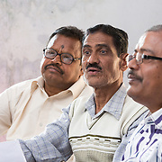 CAPTION: On the right is Damodar Shit, a retired teacher, and a new and instrumental member of Community COPE. He has been very helpful in the education domain, even before joining, working in schools and bridging the gap between schools and the health system. In the center is Daya Nidhi Shit, a retired government worker who is very active in the community. He says he is especially keen on COPE because it is ensuring access to much in healthcare that was previously unavailable in this block. Here, he is raising the issue of non-availability of appropriate medicines for snake and dog bites. On the right is Shiv Shankar Chandra, Community COPE's storekeeper. LOCATION: Pawra (village), Ghatshila (block), Purbi Singhbhum (district), Jharkhand (state), India. INDIVIDUAL(S) PHOTOGRAPHED: From left to right: Daya Nidhi Shit, Damodar Shit and Shiv Shankar Chandra.