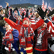 SHOT 3/22/13 6:20:10 PM - United State's soccer fan Chris Engel (center) of Milwaukee, Wis. cheers with fellow fans during a World Cup qualifying game against Costa Rica at Dick's Sporting Goods Park in Commerce City, Co. on Friday March 22, 2013. The U.S. won the game 1-0 in a spring blizzard that blanketed the pitch and fans in snow. Engel said he has now been to 11 U.S. soccer games to cheer the team on. (Photo by Marc Piscotty / © 2013).