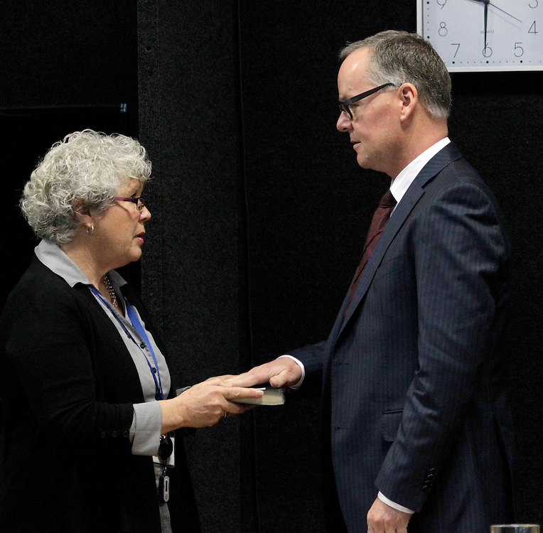 """Witness Geoff Banks gets sworn in by Louise Walton commission staff at the Royal Earthquake Commission inquiry into the collapse of the CTV building, Christchurch, New Zealand, Friday, August 17, 2012. Credit:SNPA / The Press, David Hallett  """"POOL"""""""""""
