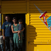 Mauritius.  Portrait of a family in front of their hardware store.