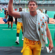 (1998)-Green Bay's Brett Favre waves to the crowd while walking to the locker room after a game.