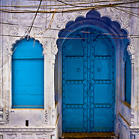 A doorway and window of a home in Old Delhi.