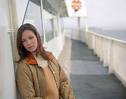 woman leaning against a ferry boat in San Francisco, CA