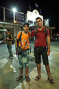 Muhammad (14, on the left) and Muhammad (18, on the right) are refugees from Syria. They met in Izmir and decided to continue travelling together. They both left their families behind because there wasn&rsquo;t enough money for everyone to travel. The youngest one comes from Aleppo and his family has a small mini market. His parents are originally from Palestine and they went to Syria as refugees. Muhammad is now a second generation refugee, this time from Syria to Europe. He has been travelling for a month before he reached Thessaloniki. The older Muhammad is from Edlib and his family has a real estate business. He has been travelling for one month and twenty days. <br /> They both keep in touch with their families via social media apps and email. <br /> They arrived to Thessaloniki in the night and they spent the night sleeping at the bus station so that in the morning they could board the bus to Eidomeni border.<br /> Refugees often arrive to Thessaloniki by train and then they go to the intercity bus station to board on the bus to Eidomeni border where they can cross to the Republic of Macedonia on foot.