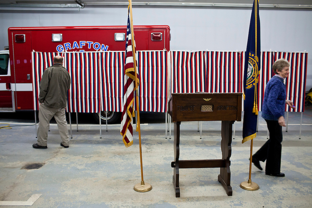 Steve Darrow, left, checks voting booths as Dorothy Campbell declares the polls open for the New Hampshire Primary at the Grafton Fire Station on Tuesday, January 10, 2012 in Grafton, NH. Brendan Hoffman for the New York Times