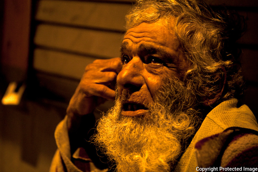 The 72-year-old Leonisio has been living on the same street corner for the past 30 years. Rubbing his thick grey beard, Leonisio recounts how he was attacked eight days ago and kicked so hard that his testicles became swollen. He had gone to the hospital for help, but due to the long wait, he returned to the street and his alcohol addiction. <br /> &quot;Why don't you come into the center?&quot; Ruiz, one of the Angels said. &quot;There's a nice warm bed there for you.&quot;<br /> Leonisio only stares back. <br /> &quot;The street is the only life he knows,&quot; Ruiz explained.  &quot;He's scared to leave it.&quot;