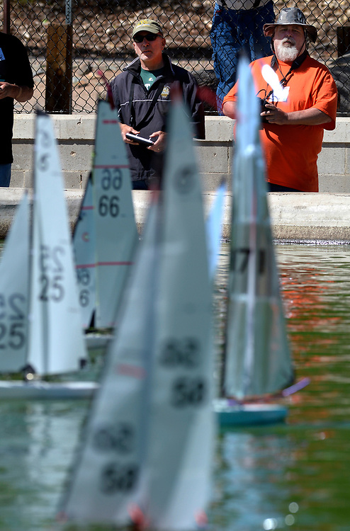 gbs042317a/ASEC -Mark Sutton of Albuquerque, left, and  Gilford Hawn of Los Lunas get their RG65 model yachts in position for the start of a race during the radio controlled Tenth Annual Rio Grande Cup Regatta at Tingely Beach on Sunday, April 23, 2017. (Greg Sorber/Albuquerque Jounal)