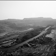 Coal mines litter the town of Dhanbad. Coal is now extracted using the surface mining method thereby destroying the landscape. 09/2010