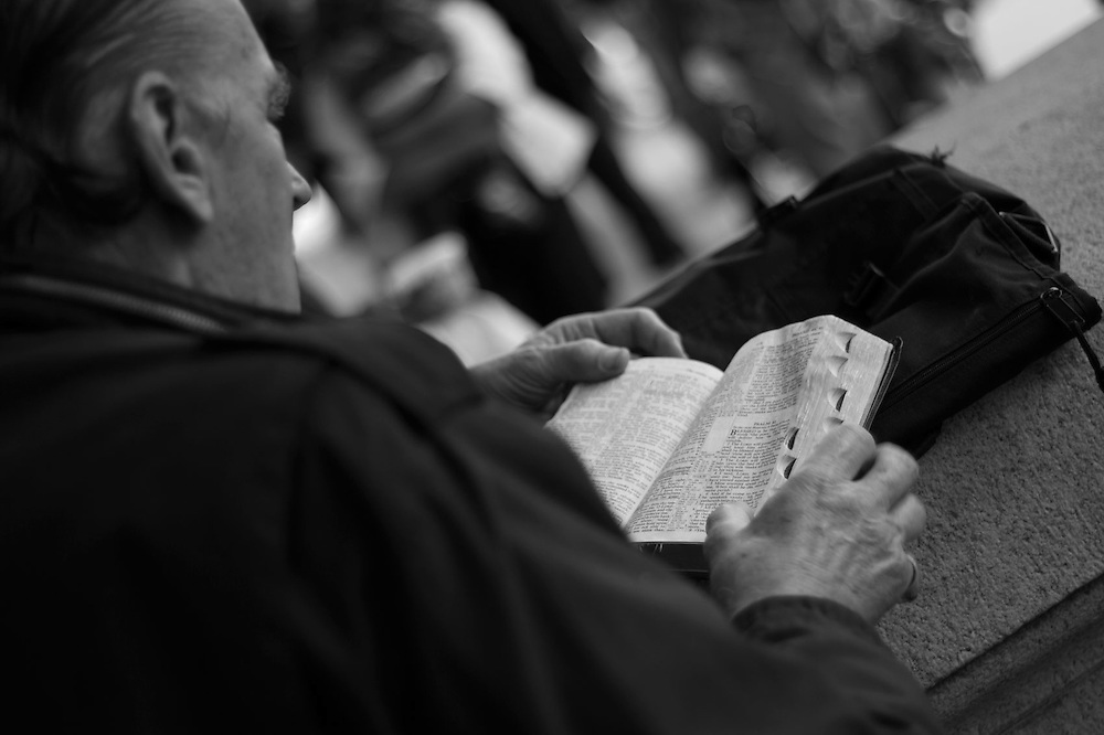 Man reads his bible professing his faith www.andersonsmithphotography.net