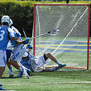 John Hopkins Goalkeeper Eric Schneider (6) falls to the turf in the 4th quarter as Duke Attacker Case Matheis (9) shot attempt enters the net during a NCAA Division I Men's Lacrosse Tournament game between the defending national champion Duke and No. 8 ranked John Hopkins Sunday, May. 18, 2014 at Delaware Stadium in Newark, DEL