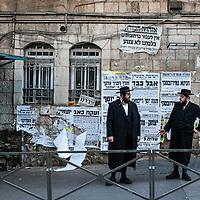 Men talk on the street in the Mea Sharim neighborhood of Jerusalem