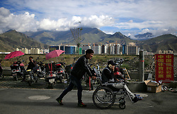 A picture made available on 19 September 2016 of locals using mobile phones on a street in Lhasa, Tibet Autonomous Region, China, 09 September 2016. Known as the 'Roof of the World' with an average elevation of 4,900 metres, Tibet, or the Tibet Autonomous Region of China, is home to some of the world's highest and largest mountains and plateaus. Its capital city Lhasa houses UNESCO World Heritage Sites like the famous Potala Palace and Norbulingka which used to be the main residences of the Dalai Lama.