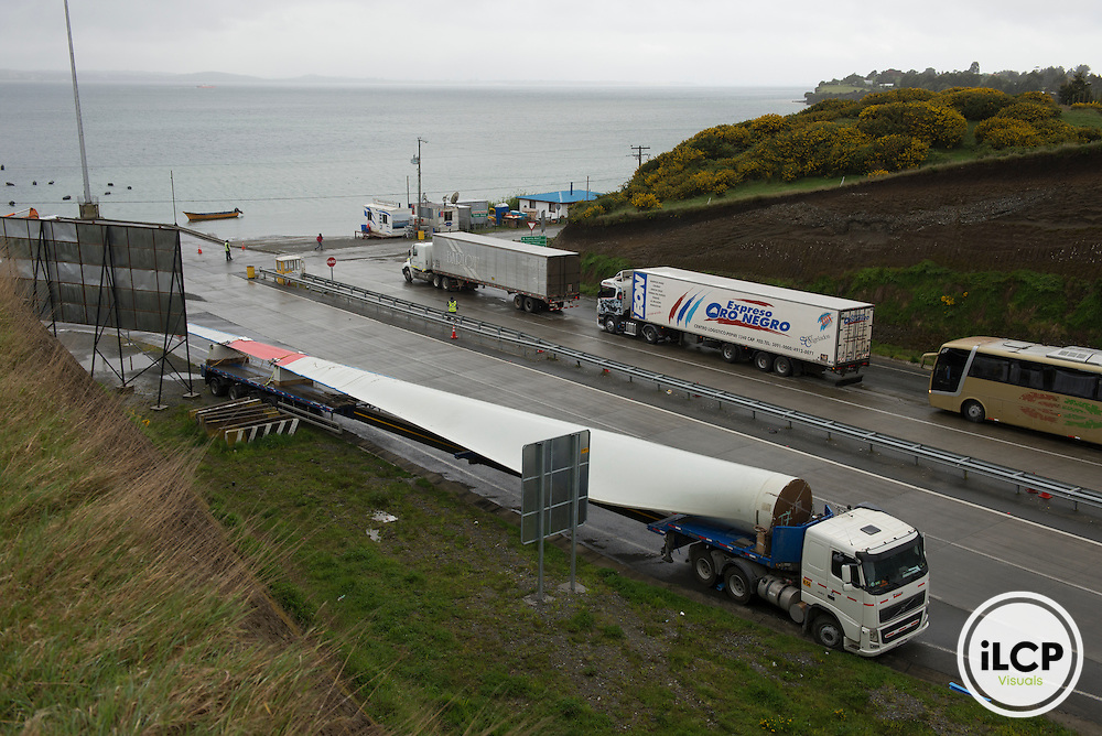 A single turbine blade on a flatbed truck awaits shipment to the San Pedro wind farm, currently under construction.