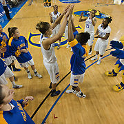 Delaware Forward Elena Delle Donne (11) high fives her teammate Delaware Guard Jocelyn Bailey (2) prior to the start of an NCAA college basketball game against George Mason Thursday, Feb. 23, 2012, at the Bob Carpenter Center in Newark, Del. (AP Photo/Saquan Stimpson)