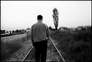 Eqrem Hoti walks along the railroad tracks that run through the village of Krushe e Mahde in Kosovo, where more than fifty men were massacred by Serb paramilitaries in 1999.