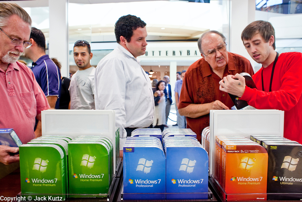 Oct. 22, 2009 -- SCOTTSDALE, AZ: Customers check out Microsoft's new operating system Windows 7 at the new Microsoft store in Scottsdale, AZ, Thursday.  Microsoft's first retail store opened in Fashion Square Mall in Scottsdale, AZ, Thursday. Microsoft's first foray into retail is widely considered to be a shot across the bow of Apple computers. The store's design is similar to Apple stores and the new Microsoft store is between two Apple stores, one in an upscale shopping mall five miles north of the Microsoft store, the other  in an upscale shopping area about 5 miles west of the Microsoft store. Microsoft used the occasion to officially launch the newest version of Windows 7, the newest version of Windows, Microsoft's flagship product.    Photo by Jack Kurtz