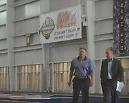 Ole Miss football coach Houston Nutt (left) walks with Kyle Campbell to a press conference to answer questions about incoming players in Oxford, Miss. on Thursday, August 4, 2011. (AP Photo/Oxford Eagle, Bruce Newman)